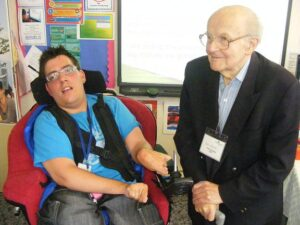 Ian with student in a wheelchair